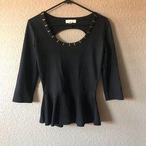 Nicky Minaj. Black with gold neckline top